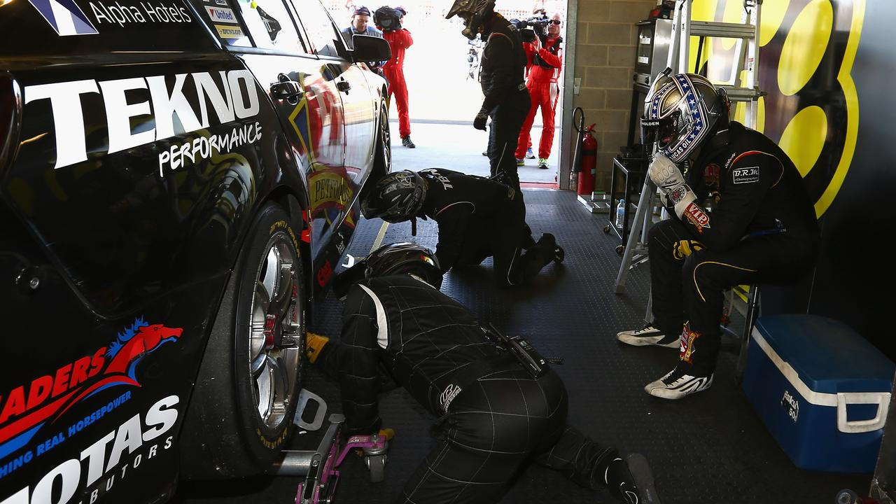 A dejected Shane van Gisbergen sits in his garage after his 2014 heartbreak. Picture: Robert Cianflone
