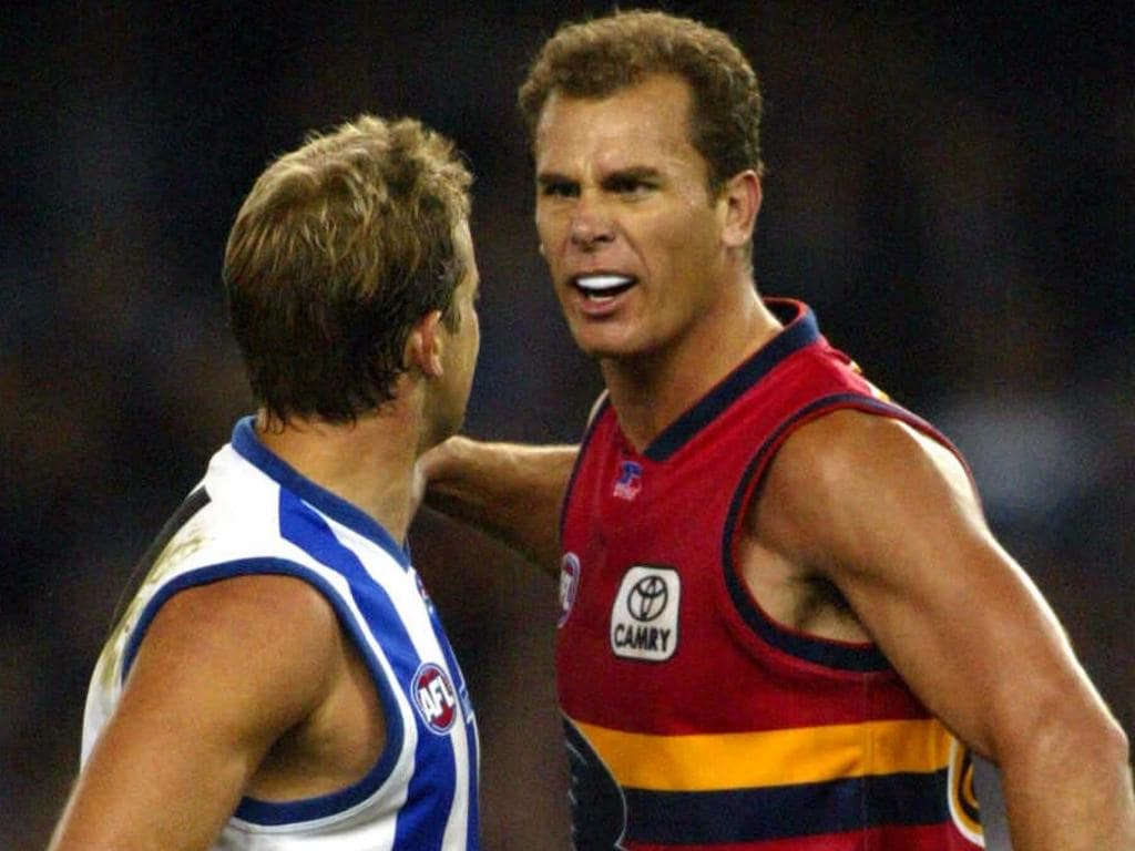 Wayne Carey (R) and Anthony Stevens clash during North Melbourne Kangaroos v Adelaide Crows at the Telstra Dome in Melbourne, 02/05/2003. Pic Colin Murty.