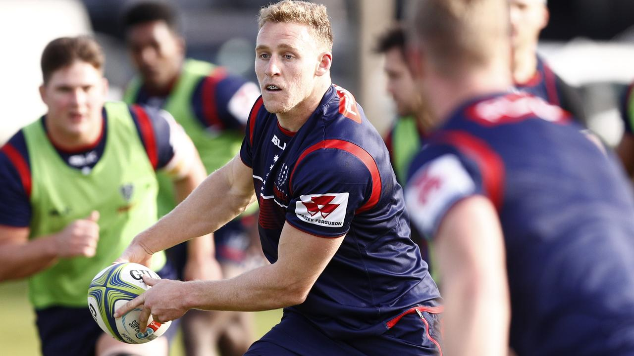 Rebels star Reece Hodge passes during a training session in Melbourne.