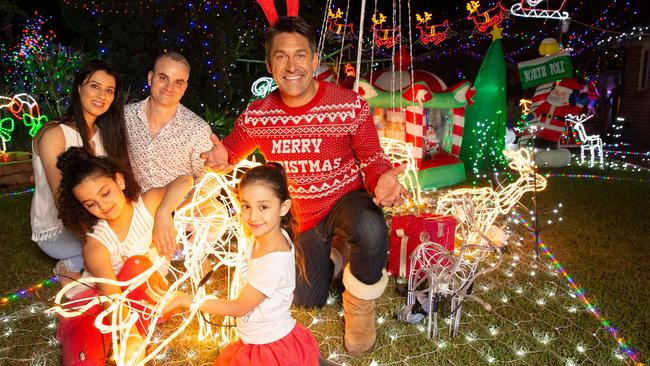 Parents Aza and Bass and daughters Sara and Sophia stop by to enjoy the lights in Davidson with Jamie Durie. Picture: Allianz Australia/Matthew Reed