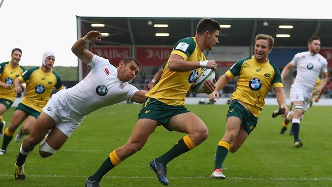 Jack Maddocks of Australia scores a try against England at the world under-20 championship.