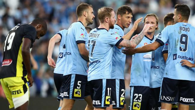 Sydney FC celebrate a goal against the Mariners.
