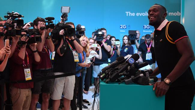Bolt was the centre of a packed press conference on the Gold Coast. Picture: AAP Image/Dean Lewins