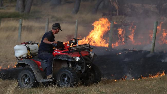 A farmer puts out a fire on his property. Picture: Alex Coppel