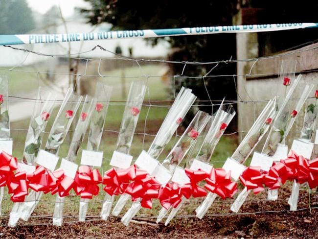Memorial of 17 red roses, one for each child and their teacher, near entrance to Dunblane Primary School, in Dunblane, Scotland in 1996.