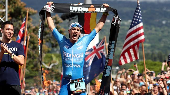 Patrick Lange celebrates crossing the finish line. Picture: Getty