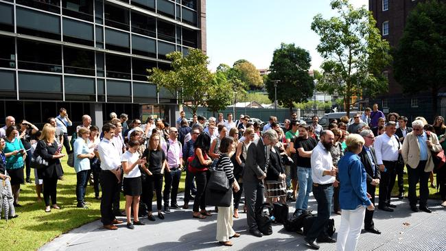 Editorial staff assemble after walking out of Fairfax Media headquarters in Sydney. Picture: AAP