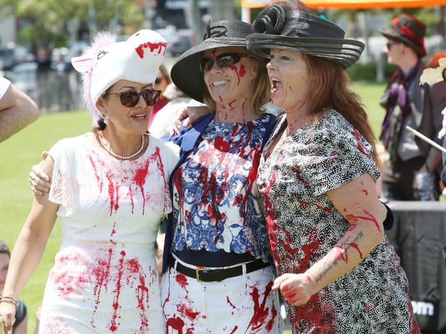 Animal activists staged a protest with mock fashion and races, covered in fake blood. Picture: AAP