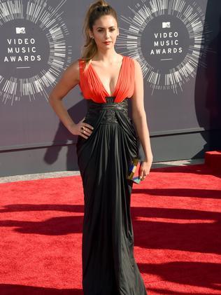 Nina Dobrev attends the 2014 MTV Video Music Awards.