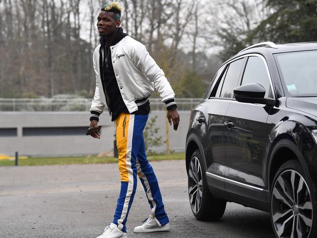 France's Paul Pogba arrives at the national football team training base.
