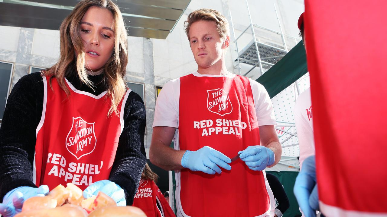 Rory Sloane and wife Belinda Riverso recently helped out with The Salvation Army Doughnut Day Challenge.