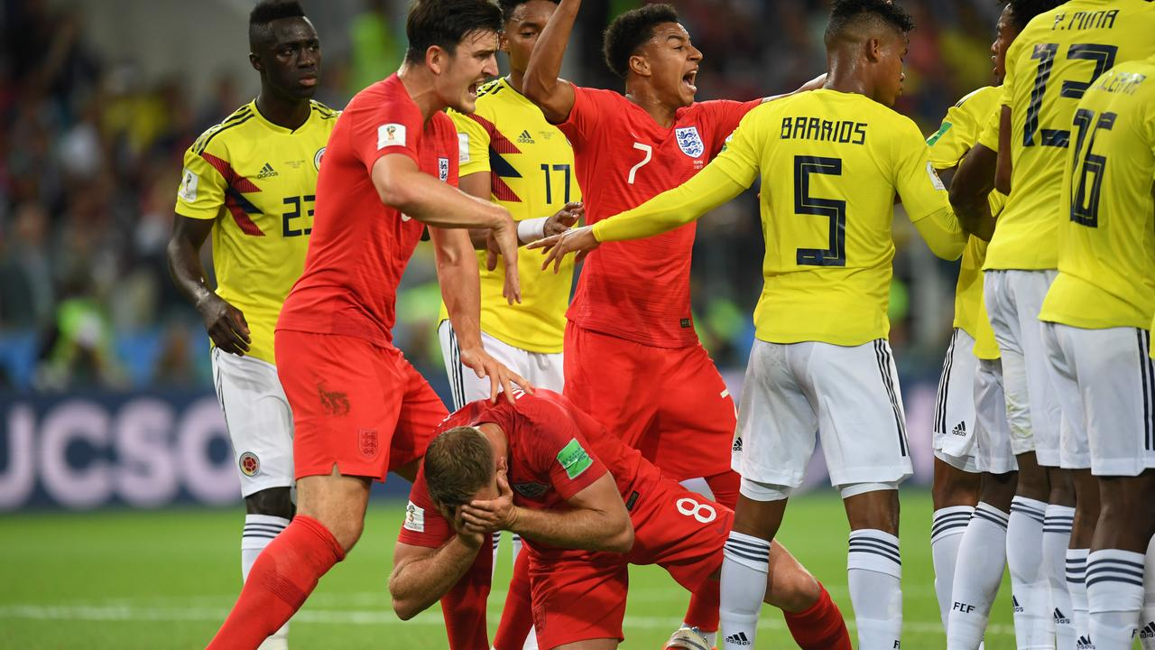 Jordan Henderson of England reacts after Wilmar Barrios of Colombia headbutts him