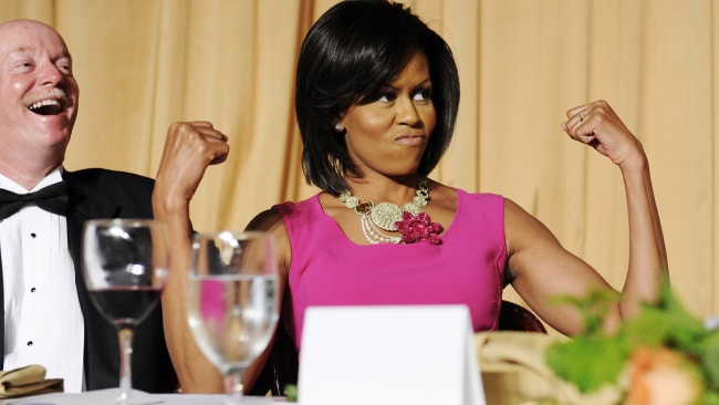 U.S. first lady Michelle Obama flexes her arms in response to a joke about her habit of wearing sleeveless dresses during the White House Correspondents' Association Dinner in Washington, 2009. Image: REUTERS/Jonathan Ernst.