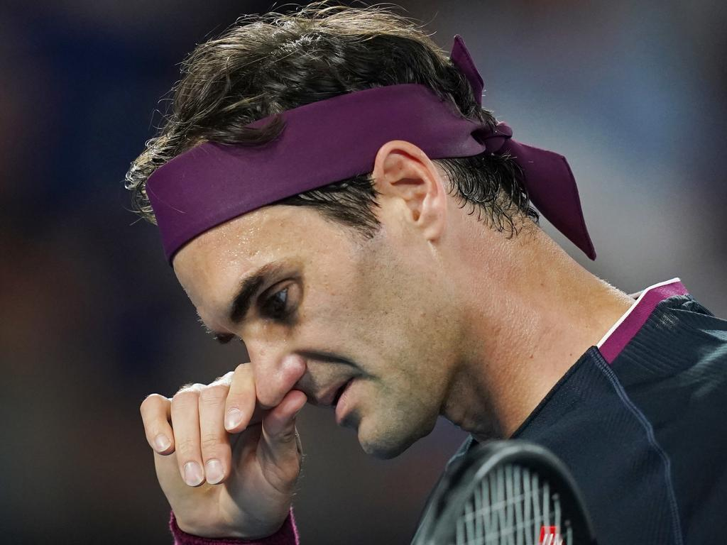 Roger Federer of Switzerland reacts during the men's singles semi final against Novak Djokovic of Serbia on day eleven of the Australian Open tennis tournament in Melbourne, Thursday, January 30, 2020. (AAP Image/Michael Dodge) NO ARCHIVING, EDITORIAL USE ONLY