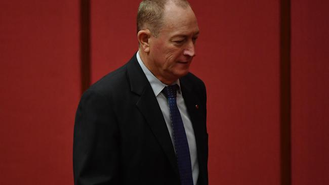 Independent Senator Fraser Anning leaving as Greens leader Richard Di Natale spoke this morning. Picture: AAP