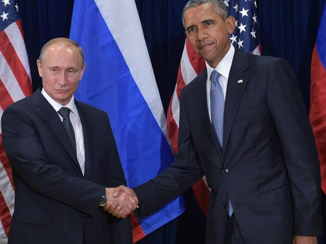 Barack Obama and Vladimir Putin pictured shaking hands on the sidelines of the 70th session of the UN General Assembly. Obama's latest move is sure to ignite tensions with Russia. Picture: AFP/ MANDEL NGAN