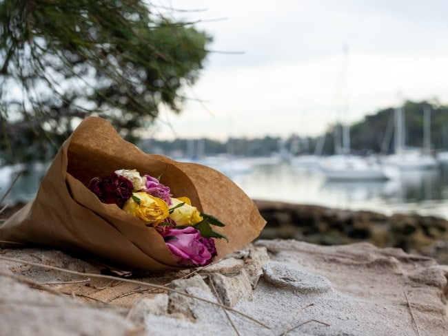 Flowers laid in honour of Cecilia Haddad on the Lane Cove River shoreline. Photo: Supplied