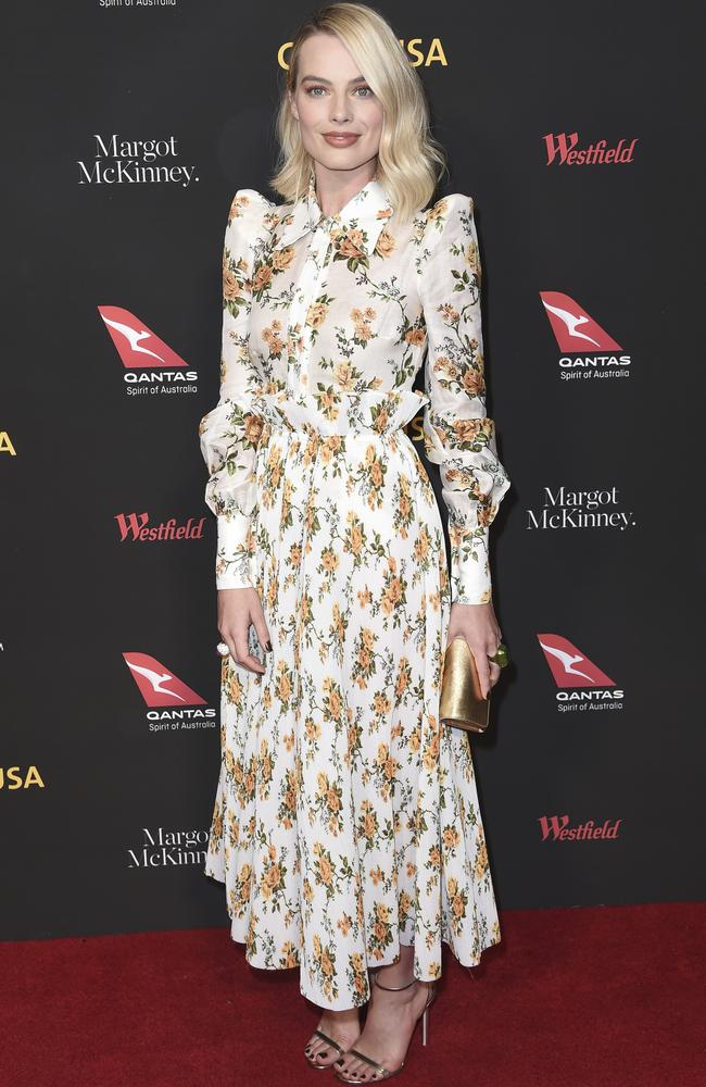 Margot Robbie, stunning in a floral print. Picture: AP