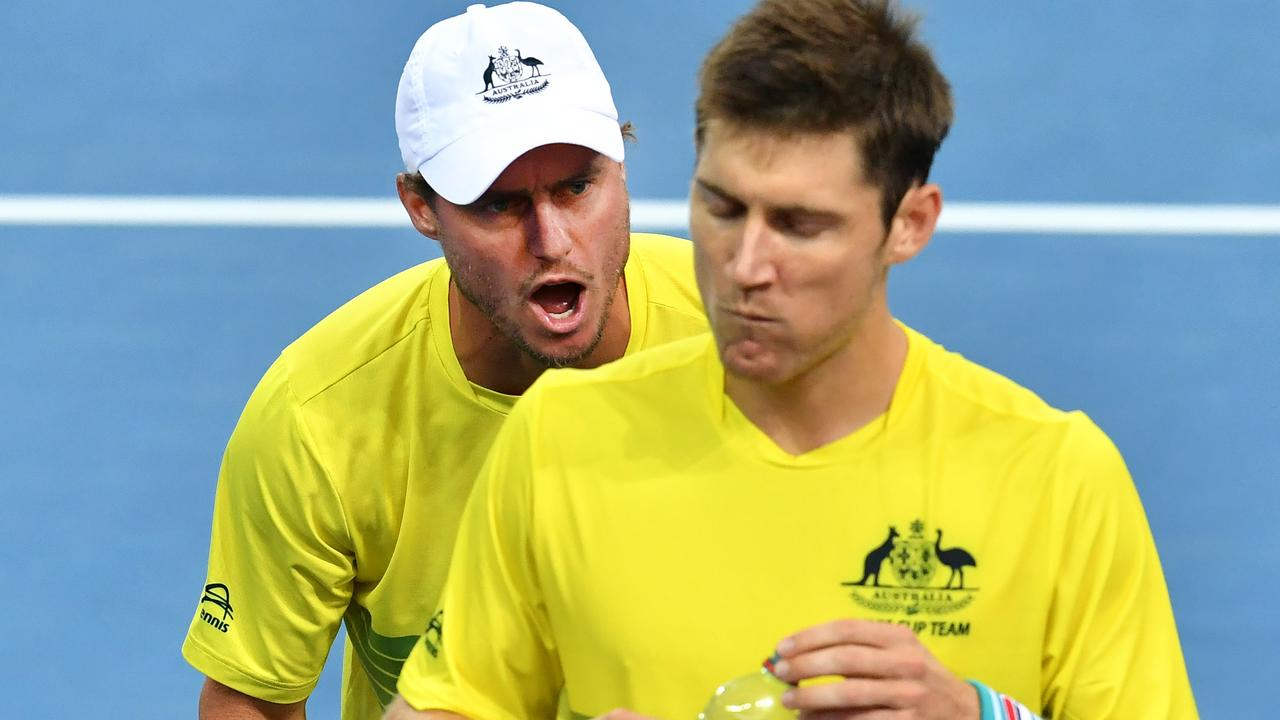Lleyton Hewitt (left) inspires Matt Ebden (right) during the Davis Cup last year — and the inspiration is showing through in Wimbledon.