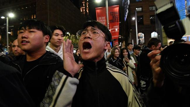 Pro-China supporters chanted slogans at pro-democracy protesters. Picture: Saeed Khan / AFP