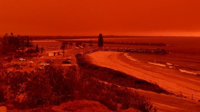 The sky turns red from bushfires burning close to Port Macquarie. Picture: Kylie Edwards