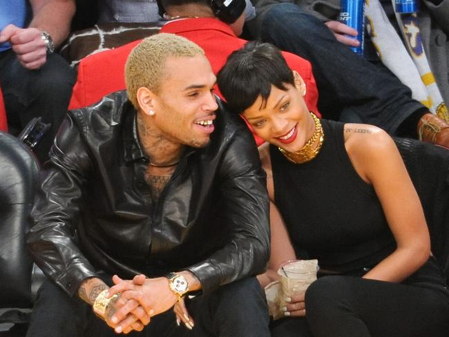 Old flame ... Chris Brown and Rihanna at a basketball game on December 25, 2012.