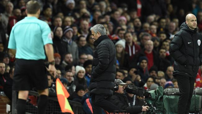 Manchester United's Portuguese manager Jose Mourinho (C) leaves the touchline.