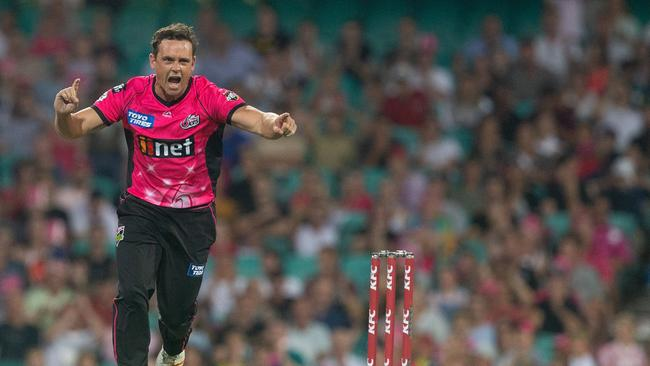 Steve O'Keefe of the Sixers celebrates taking another the wicket