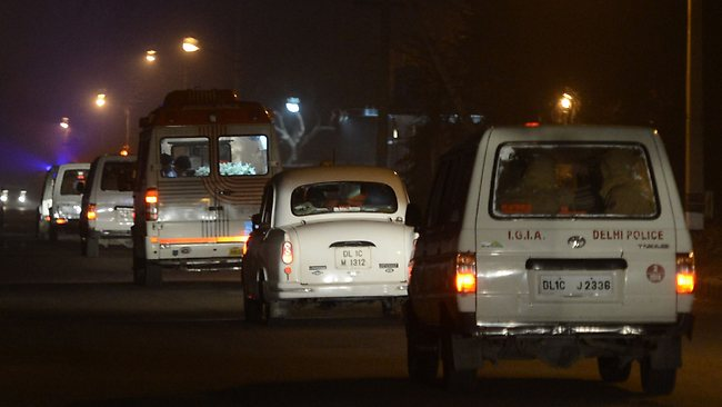 An Indian police convoy escorts an ambulance transporting the body of an Indian gang-rape victim towards her residence in New Delhi after it arrived back in India from Singapore. AFP/Sajjad Hussain