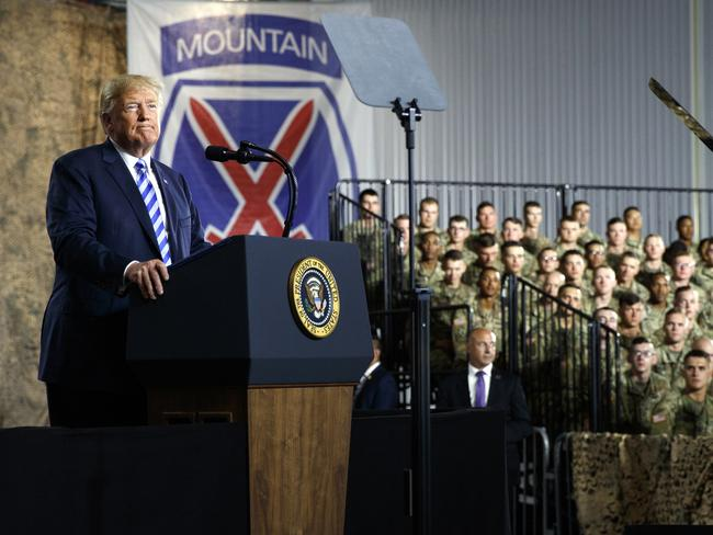 President Donald Trump pauses as he speaks before signing a $716 billion defence policy bill named for John McCain in Fort Drum. Picture: AP