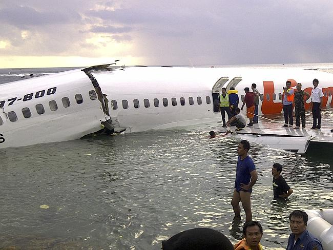 Water landing: All 101 passengers and seven crew survived when Lion Air Flight 904 went down. Picture: AP