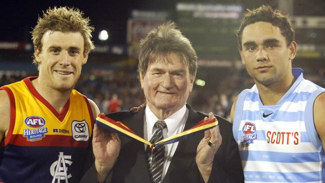 Geof Motley with one medal for tied winners Simon Goodwin and Shaun Burgoyne.