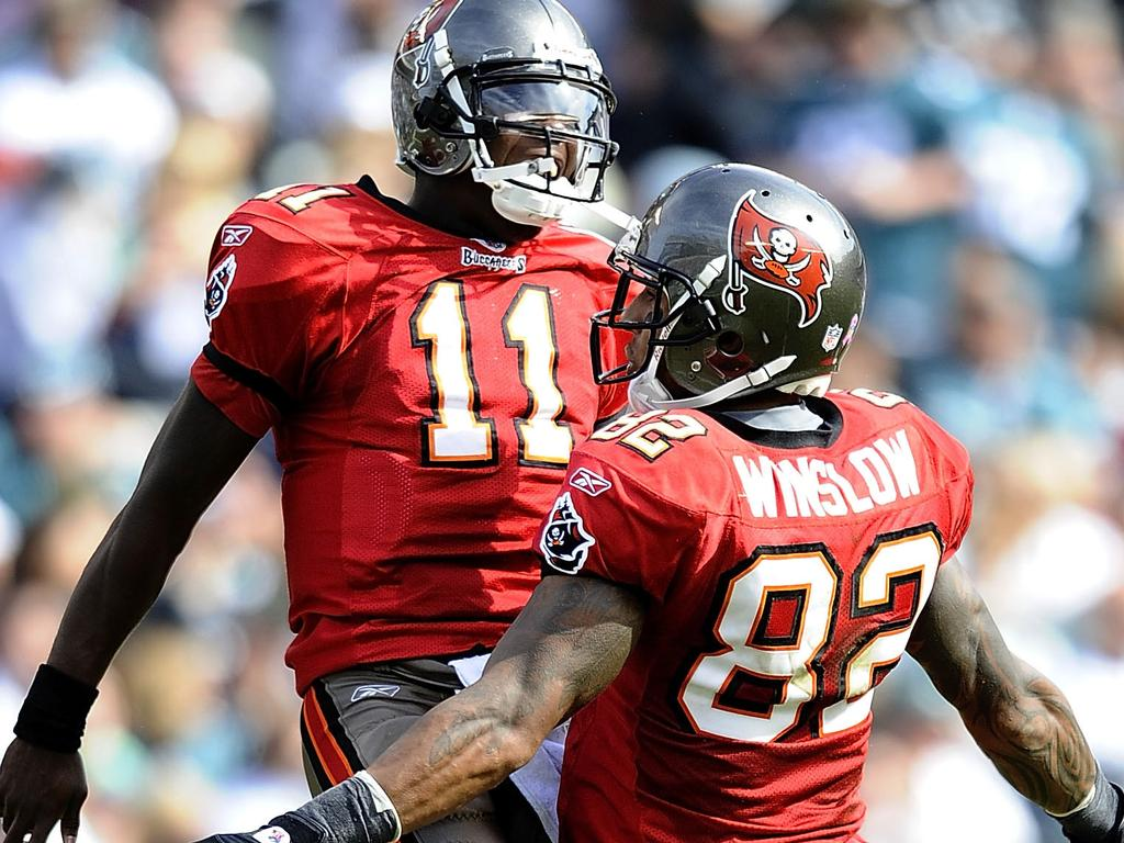 Kellen Winslow #82 and Josh Johnson #11 of the Tampa Bay Buccaneers celebrate a touchdown. Picture: Getty