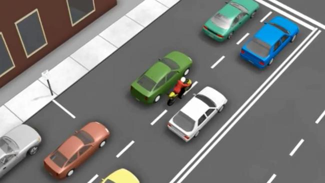 The rider is travelling at less than 30km/h and there is sufficient space between the cars. Picture: NSW Government/Facebook.