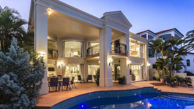 A five-bedroom home at 48 Admiralty Drive, Paradise Waters will be auctioned on Saturday at 6pm.