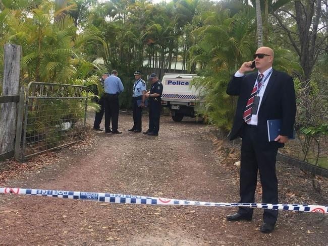 Police outside the Hervey Bay home, where a mother, father and their daughter were all shot.