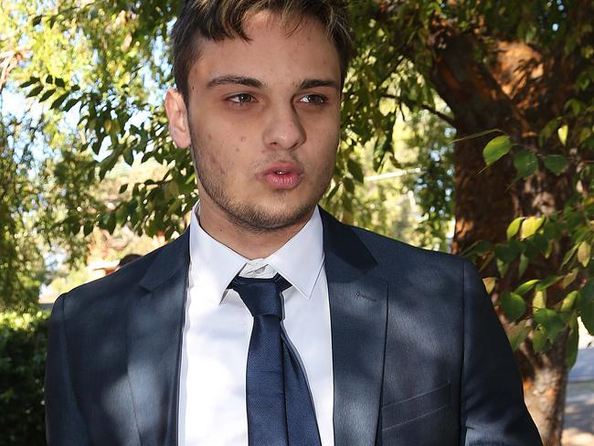 Max Towns is accused of knocking a photographer's equipment to the ground and tearing his shirt.