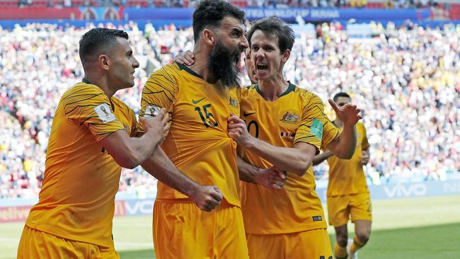 Socceroo's Mile Jedinak celebrates scoring a goal with team mates Andrew Nabbout and Robbie Kruse in the Socceroos opening 2018 World Cup match against France at Kazan Arena in Russia. Picture: Toby Zerna