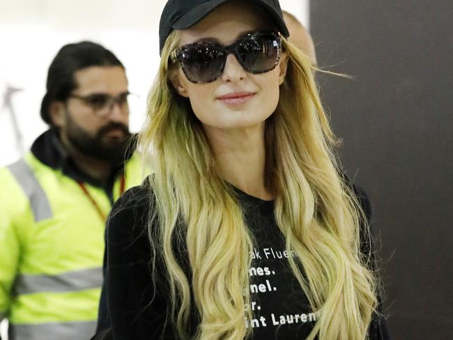 Paris Hilton arrives in Melbourne amid a fight with her ex over an engagement ring.