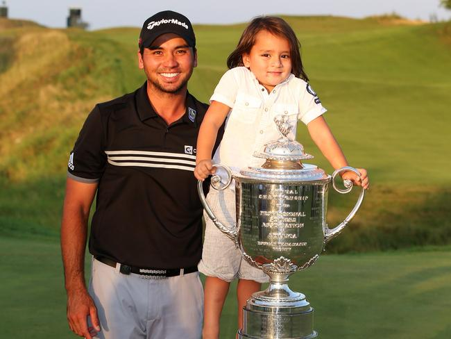 Jason Day poses with the Wanamaker Trophy and his son Dash after winning the 2015 PGA Championship. Picture: Getty Images