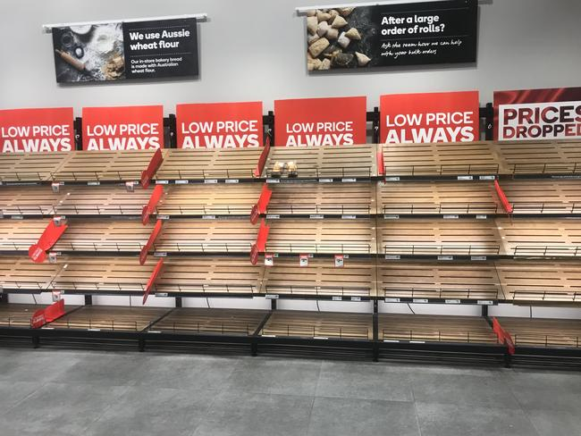 Bread? What bread? Shoppers have emptied shelves of loaves at Woolworth City Lane.