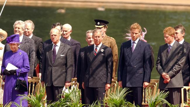 The Queen, Prince Philip, Prince Charles, Prince William and Prince Harry join the Spencer family at the opening of the memorial fountain dedicated to Princess Diana. Picture: John Stillwell/AP