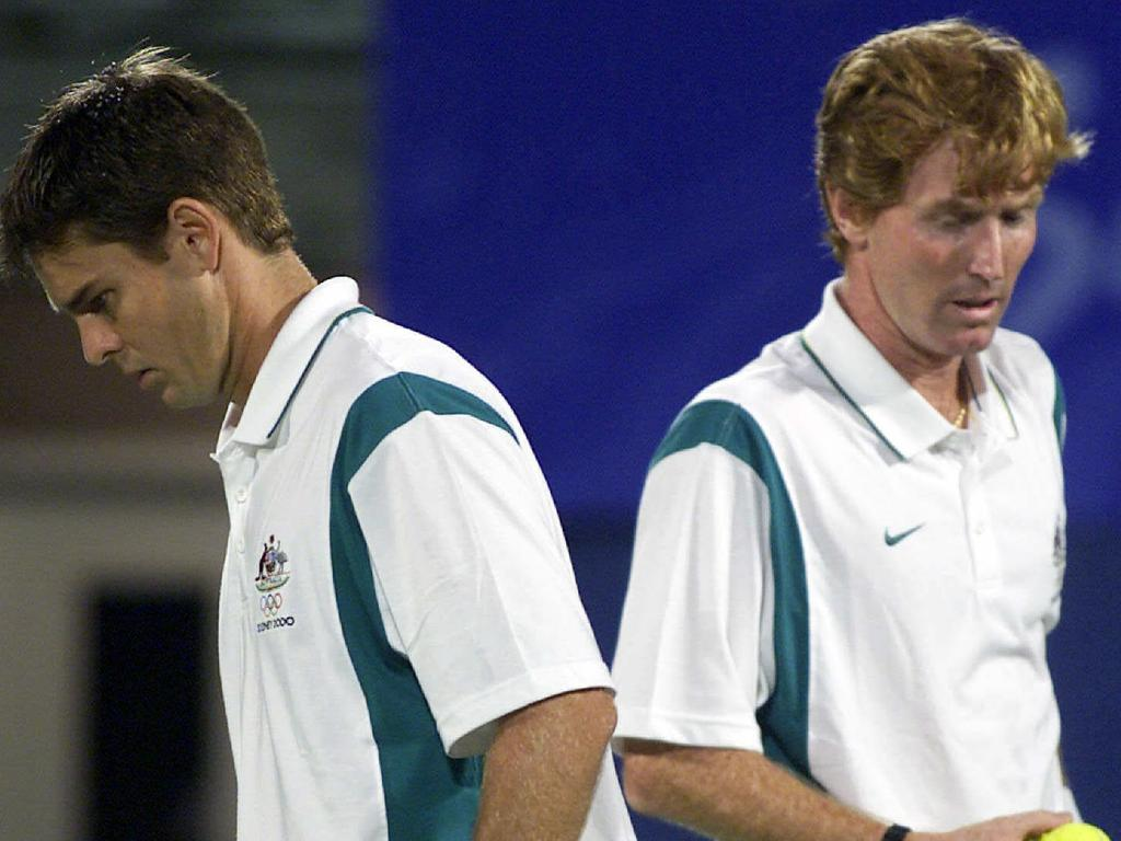 Aust tennis player Todd Woodbridge (l) with Mark Woodforde competing in Australia vs India mens doubles Sydney Olympic Games match 22 Sep 2000. a/ct bhupathi/paes/woodbridge/woodforde/match