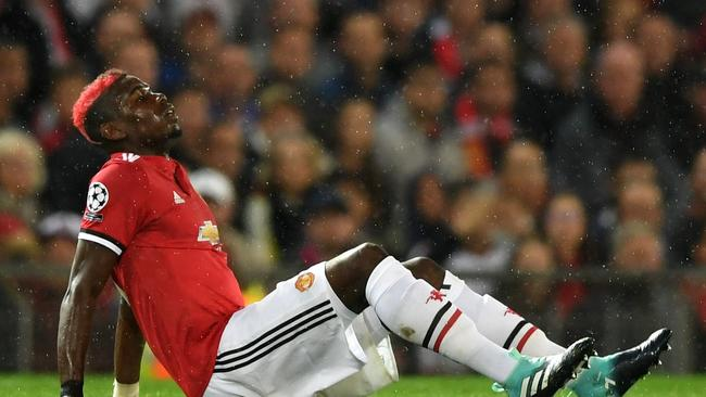 Paul Pogba of Manchester United goes down injured