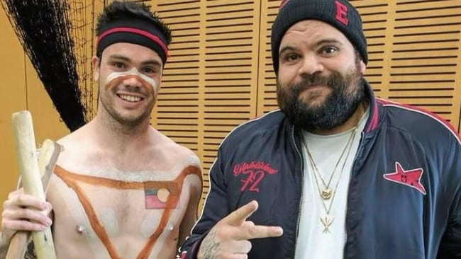 Will Austin (left) works with young people highlighting Aboriginal culture. He said his wooden instrument was suspected of being a gun.