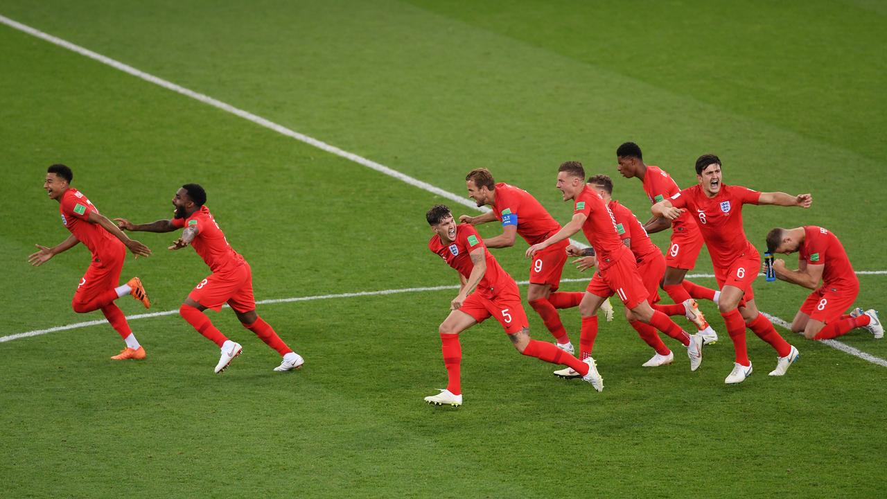 Through to the quarter finals. England rejoice after their shootout win.