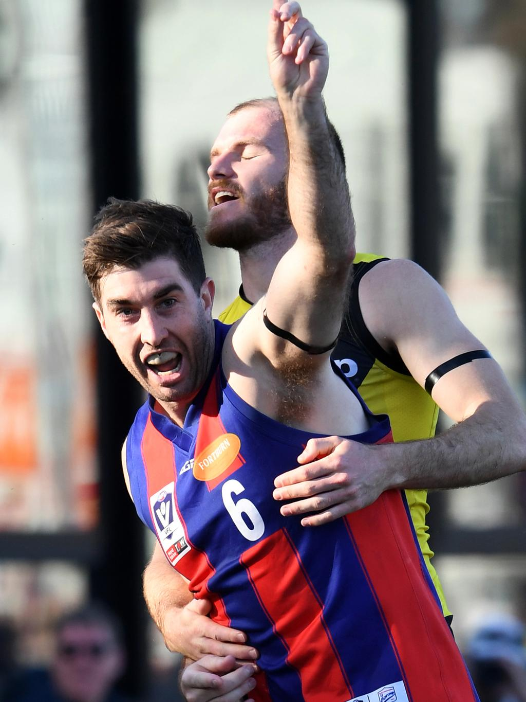 Jordie Lisle celebrates a goal for Port Melbourne, which must cut its list to 40 players next year.