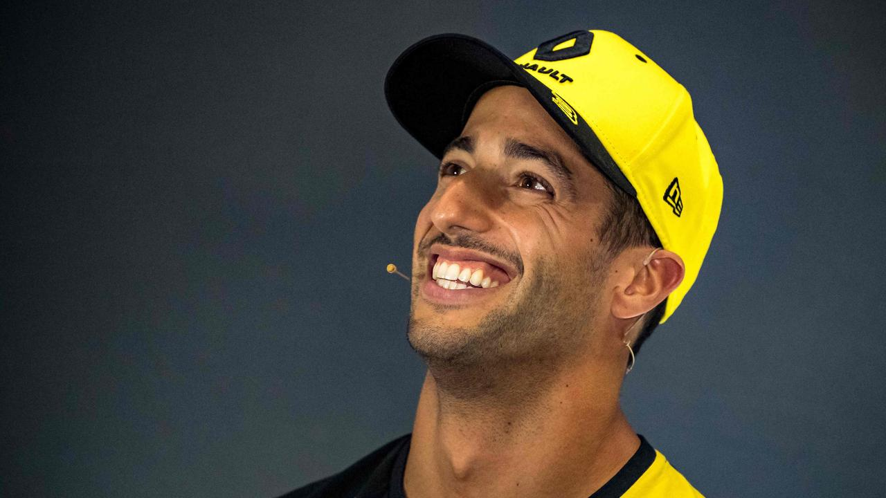 Renault's Australian driver Daniel Ricciardo was all smiles after a strong result at Silverstone. (Photo by ANDREJ ISAKOVIC / AFP)