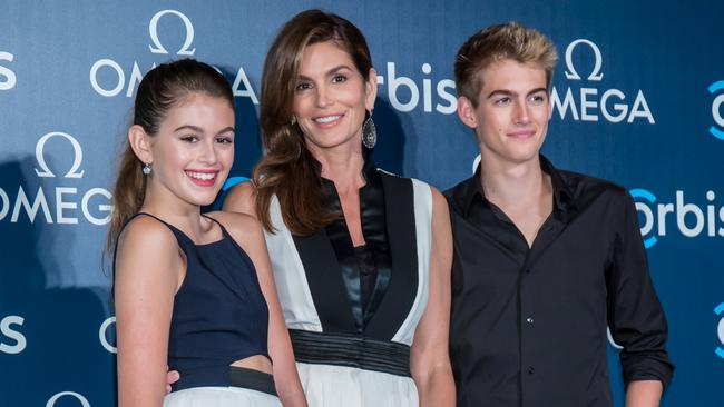 Cindy Crawford poses with her daughter Kaia Gerber and son Presley Gerber as they attend 'The Hospital In The Sky' Asian premiere in Hong Kong. (Photo by Anthony Kwan/Getty Images for Omega)