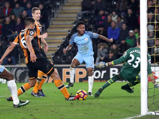 Manchester City's Raheem Sterling (C) sparks an own goal from Hull's Curtis Davies (L).
